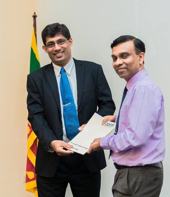 Prof. K. P. Hewagamage Received the Code of Ethics from CSSL